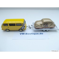 "T3 bus yellow and trailer with Beetles ""Böse Boxer Bremen"""